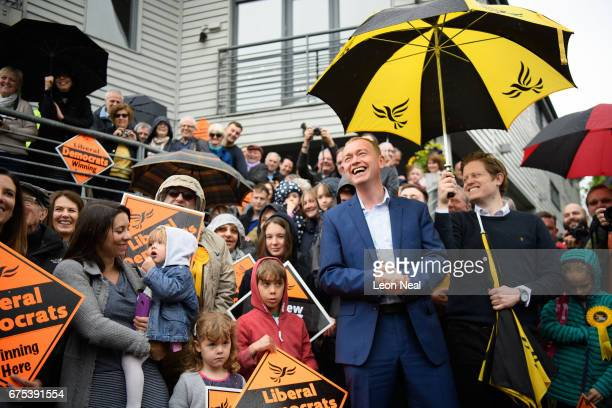 The Liberal Democrat party leader Tim Farron listens to a speech during an event at the Harts Boatyard on May 1 2017 in Surbiton England In an...