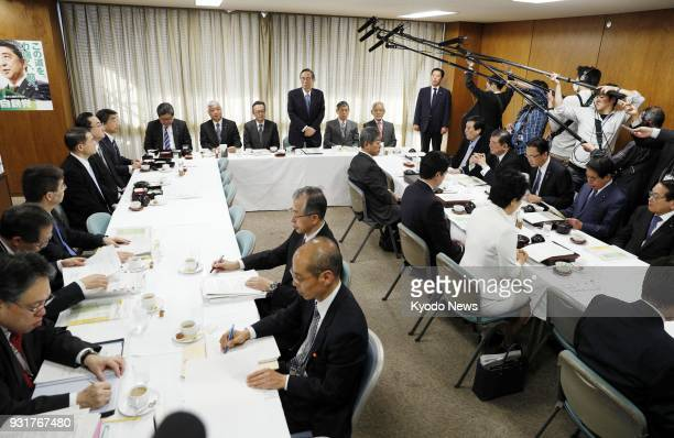 The Liberal Democratic Party's constitutional reform panel holds a meeting in Tokyo on March 14 2018 The ruling party unveiled seven options for...