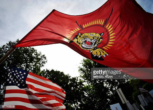The Liberation Tigers of Tamil Eelam flag is seen next to the US flag during a protest outside of the White House May 18 2009 in Washington DCThe Sri...
