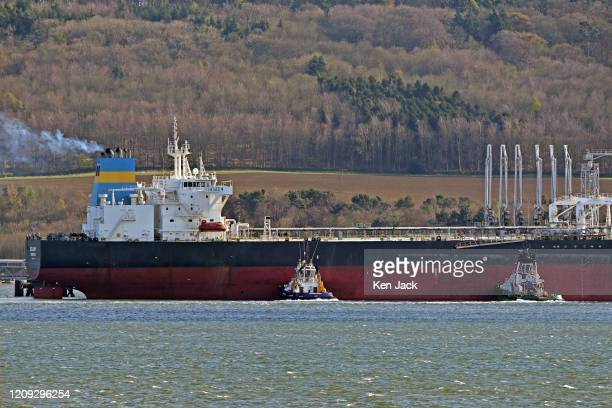 The Liberian-registered oil tanker Goldway berths at Hound Point Oil Terminal on the Forth Estuary, as uncertainty continues in the global oil market...
