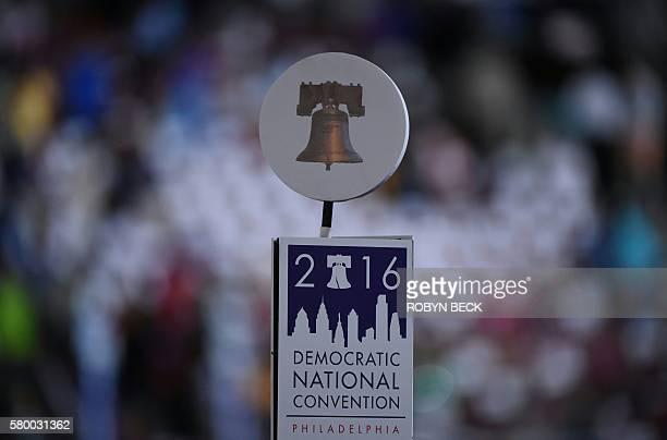 The Liberty Bell sits above a sign for the Democratic National Convention at the start of Day 1 of the Democratic National Convention at the Wells...