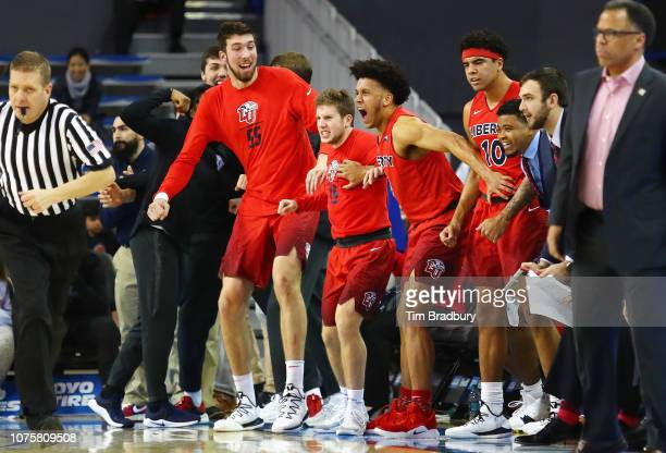 The Liberty Flames bench celebrates during the second half against the UCLA Bruins at Pauley Pavilion on December 29 2018 in Los Angeles California