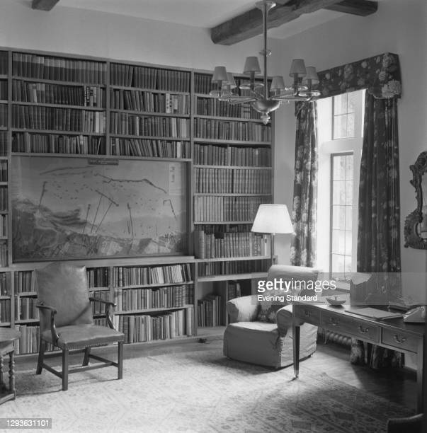 The library at Chartwell, the country home of former British Prime Minister Winston Churchill in Kent, UK, June 1966. Amongst the books is a map of...
