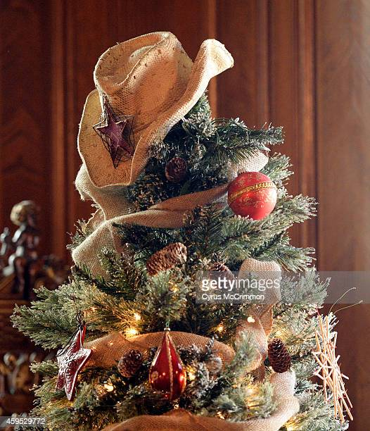 The library christmas tree has a cowboy on top as interior decorators from the American Society of Interior Designers Colorado Chapter began...