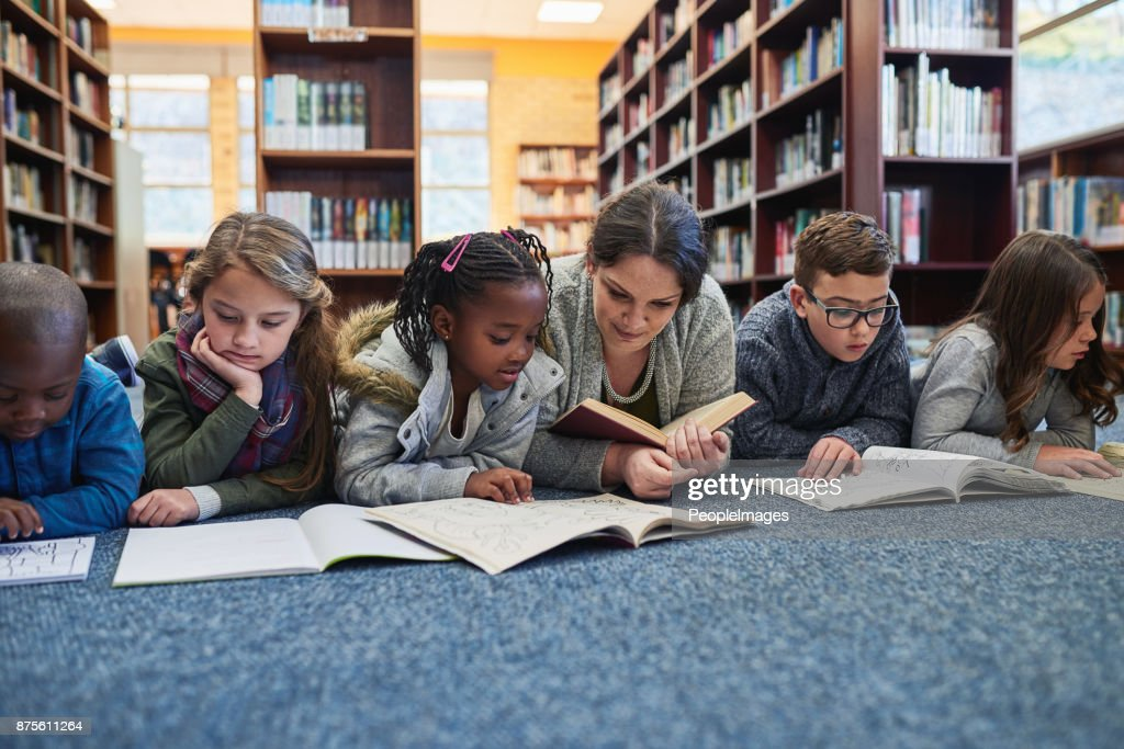 The library is their favourite place to learn : Stock Photo
