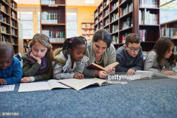 the library is their favourite place to learn - reading stock pictures, royalty-free photos & images