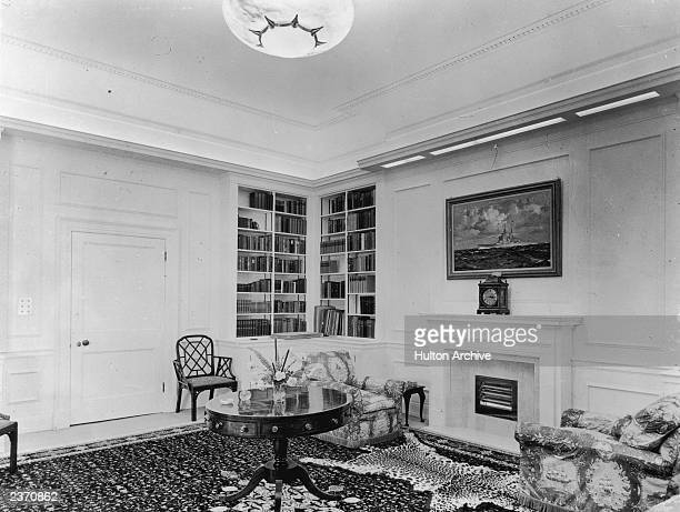 The library of Clarence House in London, 1949. The house was built in 1825-27 by John Nash for the Duke of Clarence, later King William IV. The...