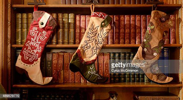The library stockings are cowboy boots as interior decorators from the American Society of Interior Designers Colorado Chapter began decorating the...