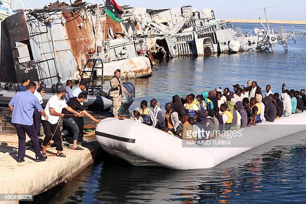 The Libyan coastguard pull a boat carrying illegal African migrants rescued as they were trying to reach Europe at a naval base near the capital...