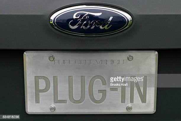 The license plate of a Ford HySeries Edge on display on the South Lawn of the White House reads 'PLUGIN' President George W Bush inspected...