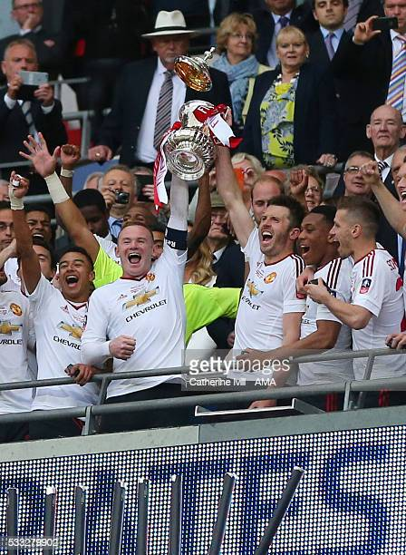 The lid of the FA Cup trophy can be seen falling as Manchester United celebrate the win after The Emirates FA Cup final match between Manchester...