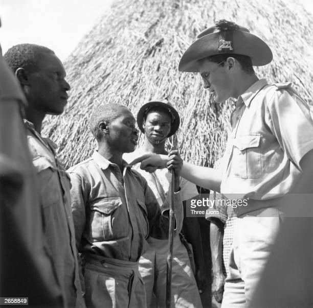 The lieutenant of the Kenyan Constabulary issuing instructions for a raid on a village where Mau Mau raiders were thought to live