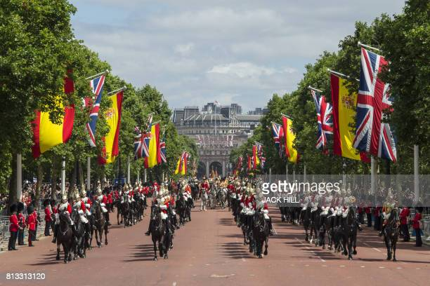 The Life Guards members of the household cavalry escort the State Carriage of Britain's Queen Elizabeth II and Spanish King Felipe VI as they travel...