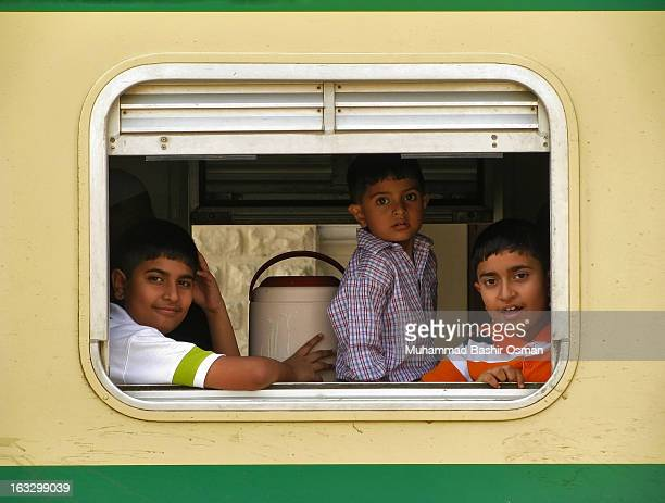 The life scene at Karachi Cantt., Railway Station showing trio of little kids, seemingly happy for going to the journey on ....! Though the railways...