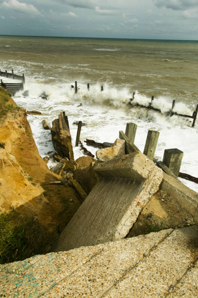 The lifeboat launching ramp destroyed at Happisburgh on the Norfolk Coast. This section of coast is the fastest eroding point in the uK and speeding up to to global warming induced sea level rise and increased stormy weather.