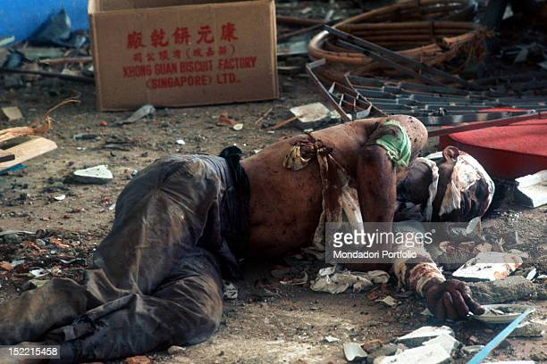 The lifeless body of a Vietnamese guerrilla on the ground wounded and dead because of an explosion Ku Chi 1968