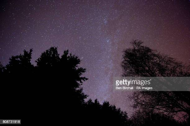 The light band of the Milky Way edge is seen in the centre of an image of the night sky over Exmoor National Park.
