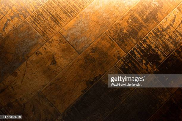 the light hits the beautiful wood grain tile surface. - チーク ストックフォトと画像