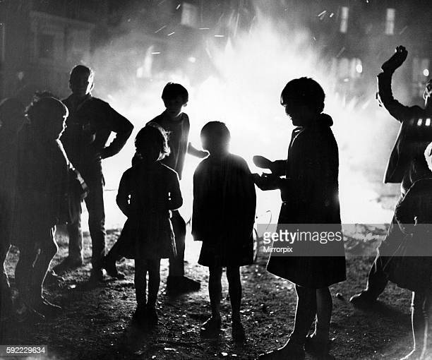 The light of a bonfire that fascinates children everywhere this scene was in Park Lane Liverpool 5th November 1966