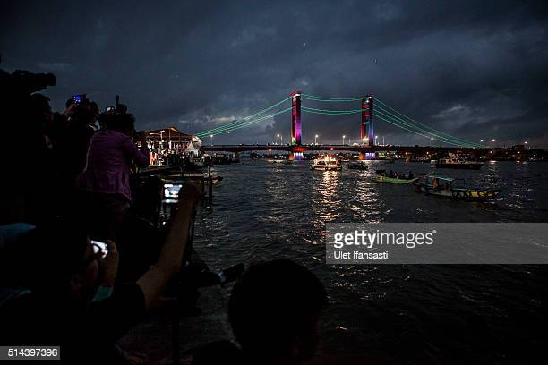 The light of Ampera Bridge is seen during a total solar eclipse in Palembang city on March 9 2016 in Palembang South Sumatra province Indonesia A...