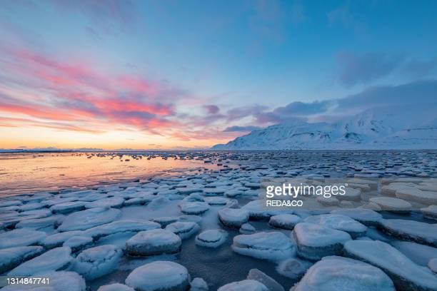 The light of the sunrise illuminated the frozen landscape. Longyearbyen. Svalbard. Norway. Europe.