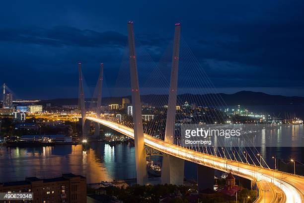 The light trails of road traffic pass across Golden bridge at night on Golden Horn Bay in Vladivostok Russia on Sunday Sept 27 2015 'It is simply...