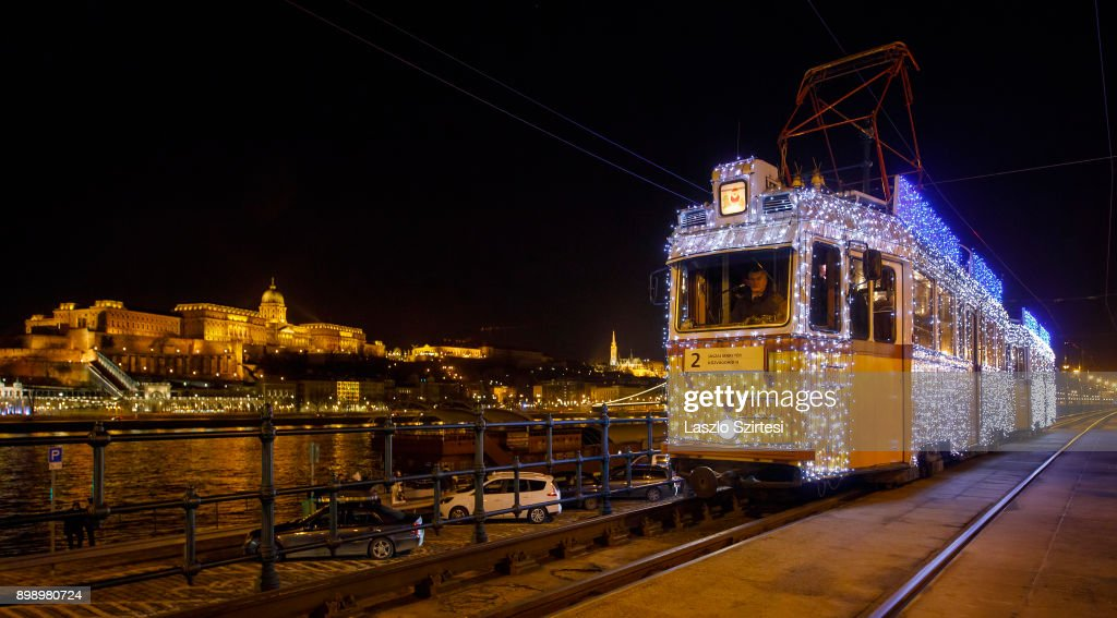 The 'Light tram' operates along the riverside of the Danube at the Vigadó tér (Vigado square) on December 25, 2017 in Budapest, Hungary.