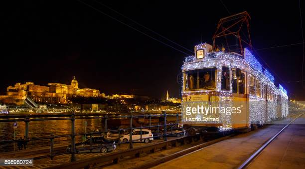 The 'Light tram' operates along the riverside of the Danube at the Vigadó tér on December 25 2017 in Budapest Hungary