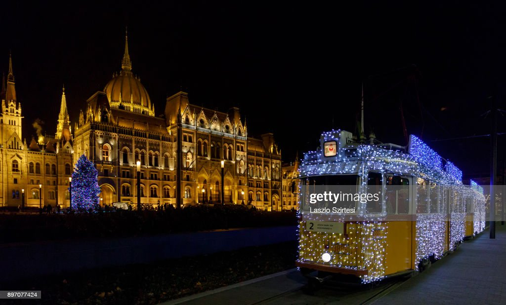 The 'Light tram' operates next to the Parliament Building at Kossuth tér (Kossuth square) on December 19, 2017 in Budapest, Hungary.