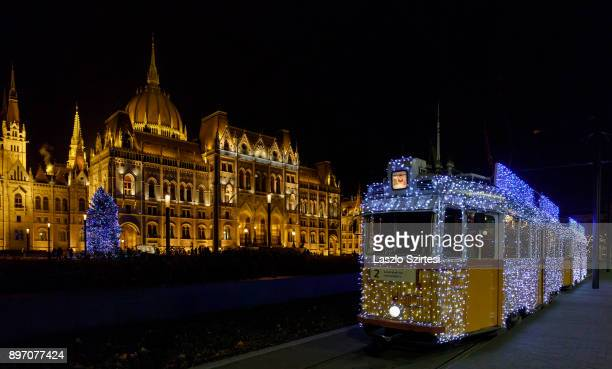 The 'Light tram' operates next to the Parliament Building at Kossuth tér on December 19 2017 in Budapest Hungary