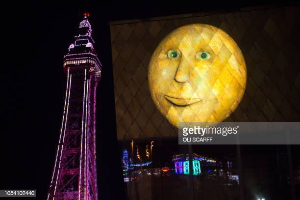 The lightart installation entitled 'Lancashire Moon' by artist Hannah Fox is projected onto The Wedding Chapel adjacent to Blackpool Tower and...