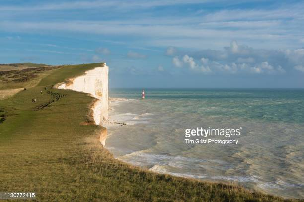 the lighthouse at beachy head, east sussex. - beachy head stock photos and pictures