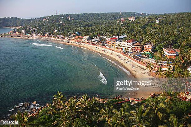 The lighthouse beach and beachfront with shops restaurants and guesthouses of Kovalam on December 13 2009 in Kovalam Beach near Trivandrum Kerala...