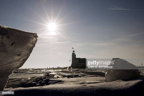 The lighthouse 'het Paard' on the former island of Marken on the IJsselmeer peninsula is surrounded on February 12 by driftice AFP PHOTO / ANP MARCEL...