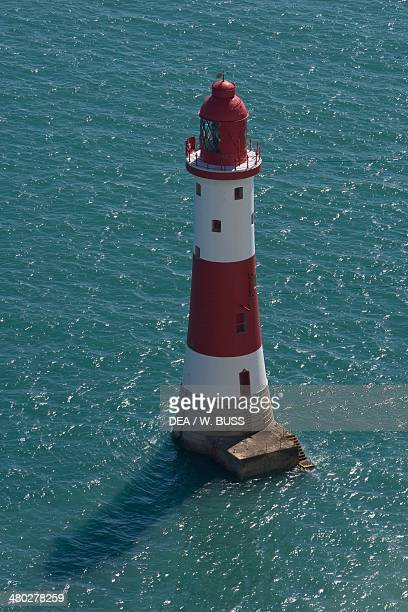 The lighthouse in the sea below Beachy Head on the English Channel East Sussex United Kingdom
