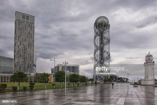 the lighthouse,alphabetical tower and skyscrapers at batumi shoreline. - emreturanphoto stock pictures, royalty-free photos & images