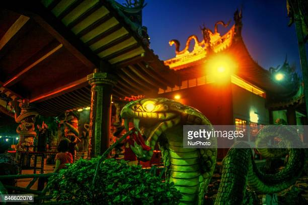 The lighting decoration of altar at night is the entertainment for ghosts is seen inside the Snake temple during Hungry ghost festivals in Teluk...