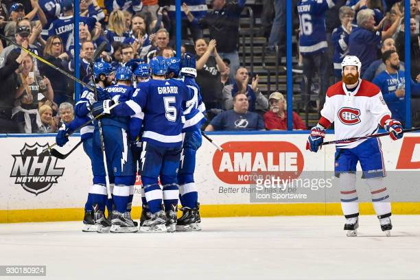 The Lightning celebrate Tampa Bay Lightning right wing Nikita Kucherov's gametying goal during the third period of an NHL game between the Montreal...