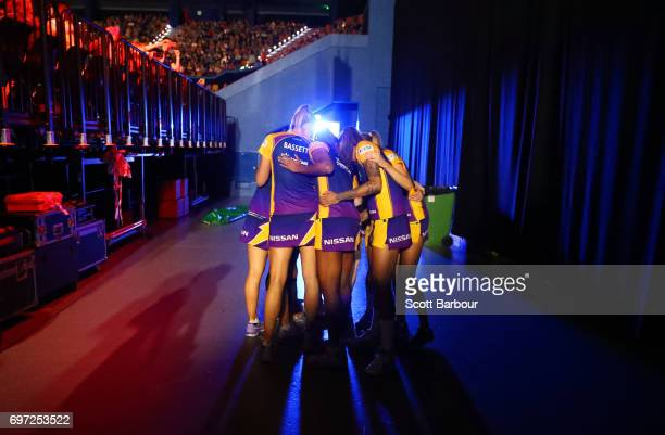 The Lightning form a huddle as they wait back stage to be called onto the court during the Super Netball Grand Final match between the Lightning and...