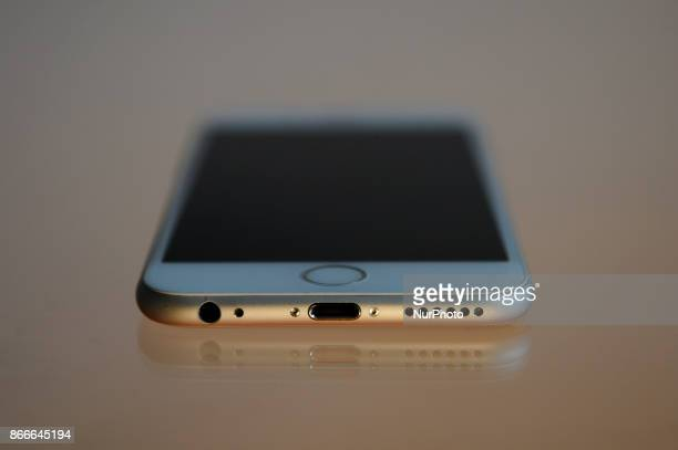 The Lightning port and headphone jack on the bottom of an iPhone 6 are seen on a glass table on October 25 2017