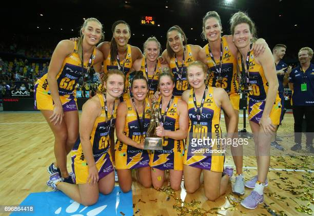 The Lightning pose for a team photo with the Suncorp Super Netball trophy after winning the Super Netball Grand Final match between the Lightning and...