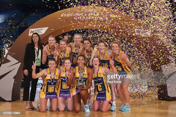 The Lightning pose with the championship trophy after winning the Super Netball Grand Final match between the West Coast Fever and the Sunshine Coast...