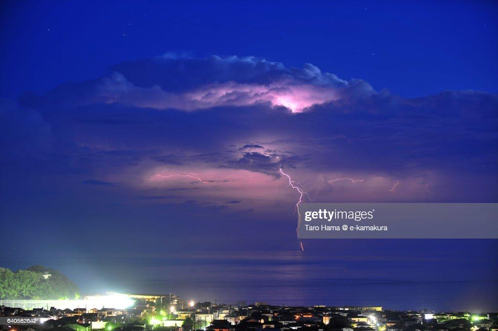 The lightning thunder on the night beach : ストックフォト