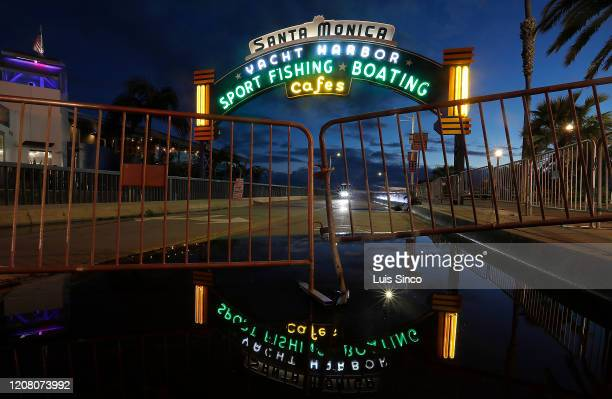 The lights are on but the Santa Monica Pier is closed to the public on Thursday, Mar. 19, 2020. Gov. Gavin Newsom has ordred California residents to...