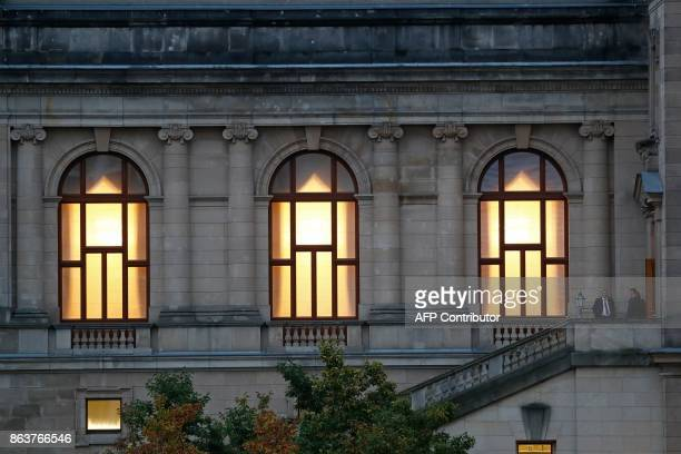 The lights are on in the building of the German Parliamentary Association where members of the delegations of the CDU/CSU conservative alliance, the...