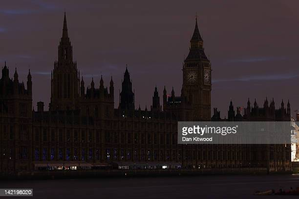 The lights are turned off on The Houses of Parliament in central London to mark 'Earth Hour' on March 31 2012 in London England According to...