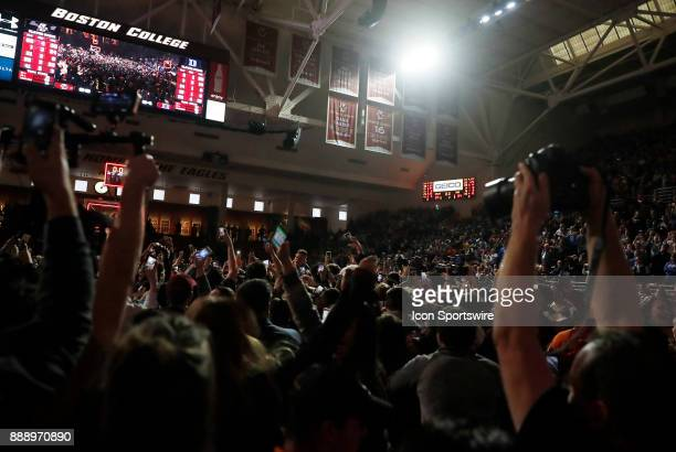The lights go out briefly as the fans storm the court during a game between the Boston College Eagles and the Duke University Blue Devils on December...