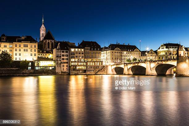 The lights of Basel city reflecting on the Rhine river