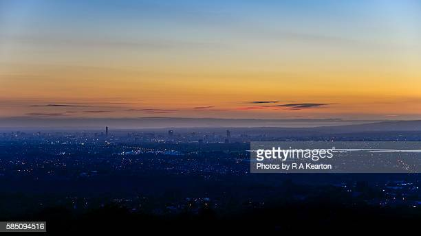 The lights of Manchester, England at dusk