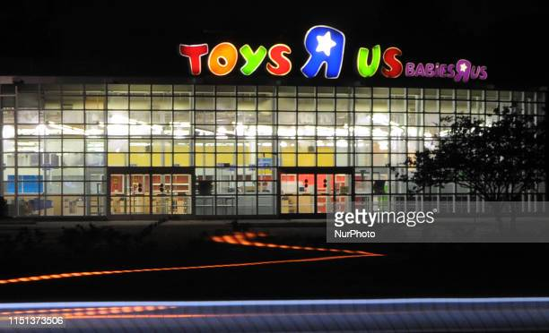 The lights of passing cars are seen at a shuttered Toys R Us store on June 21, 2019 in Orlando, Florida. Toys R Us is reportedly planning to reopen...